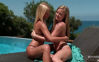 Young lesbians enjoy the sun with an increment of each other's pussy