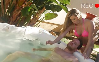 Alluring babe removes her pink bikini for a nice fuck by the pool