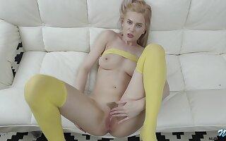 Blonde unshaded Avrora White in yellow socks fingers her wet pussy