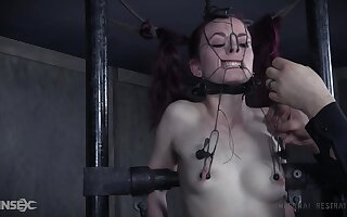 Redhead teen slave Ivy Addams in a painful torture session